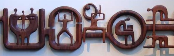<p>Frank Hayden, <em>A Sequence of Life</em>, 1974, carved Honduran mahogany, 51 x 269 inches. Loaned by Hancock Bank, L5.2002.</p>